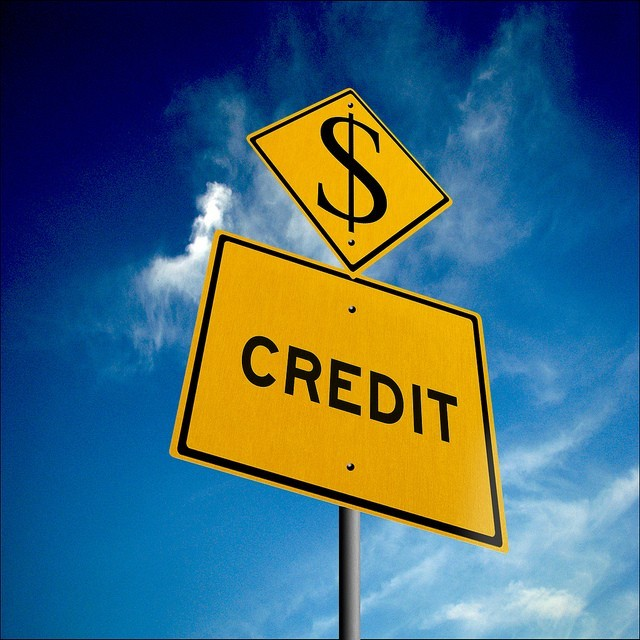 Road sign that says credit and has a dollar sign above it. For build your credit without a credit card article.