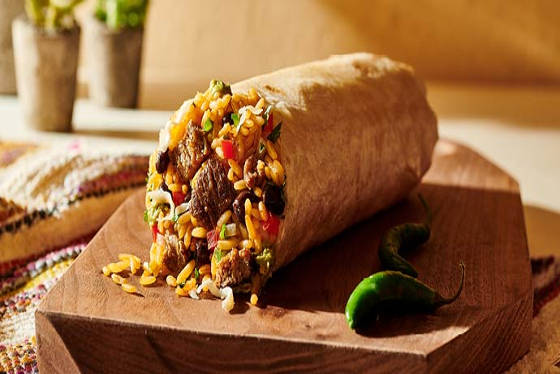 A burrito stuffed with beef, rice and lots of other yumminess.