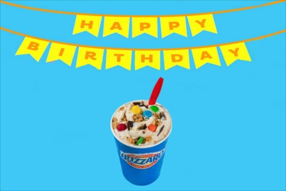 "A ""Happy Birthday"" banner over a small blizzard from Dairy Queen."