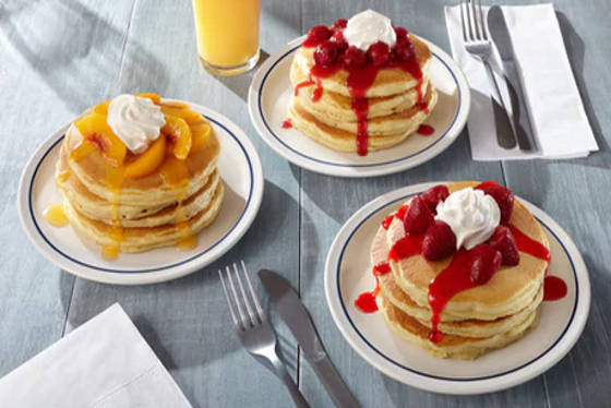 Stacks of pancakes covered with fruit, a birthday freebie from IHOP.