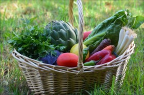 Wicker basket of produce for frugal cooking tips.
