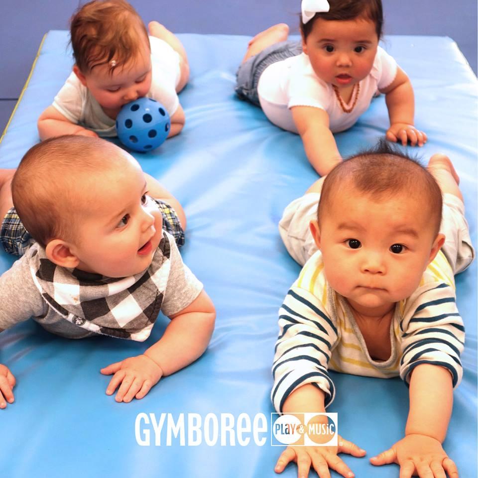 Four babies attending a free Gymboree class.